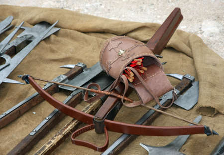 guerrilla: wooden crossbow with arrows and other ancient and medieval weapons
