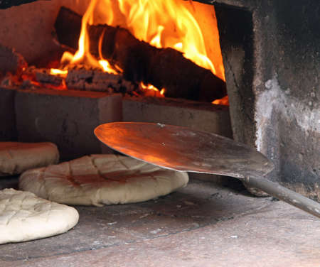 woodfired: loaves and pieces of raw bread cooked in the wood-fired oven Stock Photo