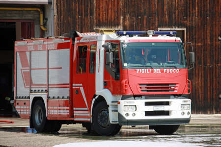shutting: fire truck after shutting the burning of a house in the city Stock Photo