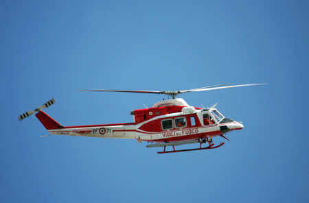 patrol helicopter of firefighters in blue sky over a fire 5 Stock Photo - 19598777
