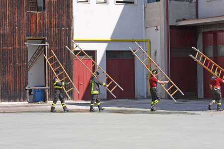 exercise and training of firefighters in the fire station with wooden ladder Stock Photo - 19604566