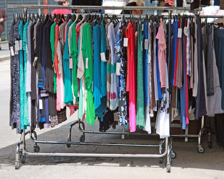 travelling salesman: clothes stand along the road street market of the city Stock Photo