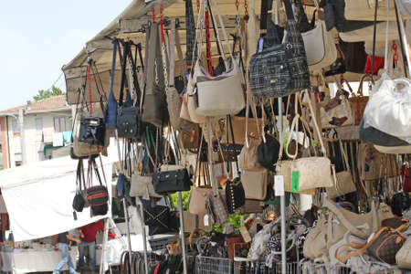 travelling salesman: stand bags and fashion accessories market across the street of the city