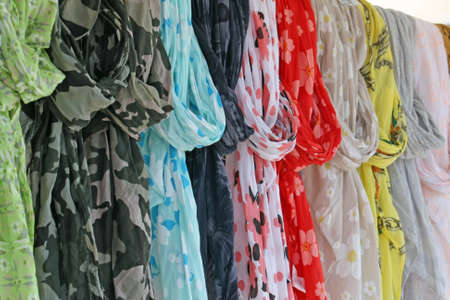 travelling salesman: scarves and fuoulard of all colors on sale at the local market