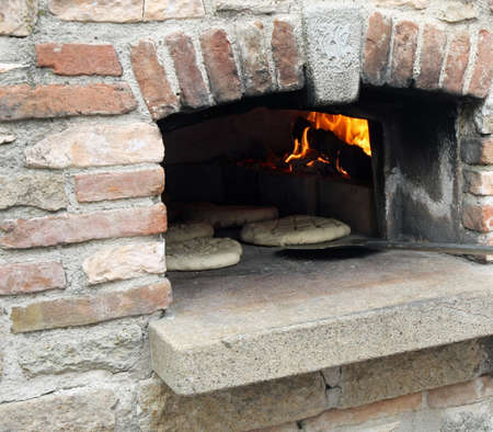 loaves and pieces of raw bread cooked in the wood-fired oven photo