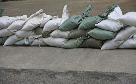 sandbag: sandbags to protect against flooding of the River during the flood