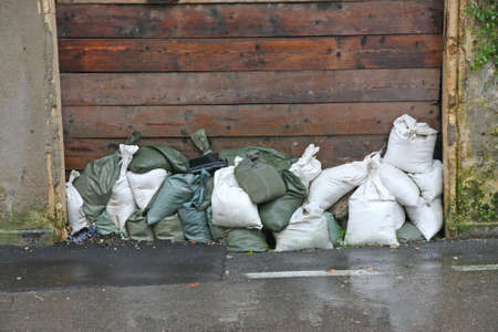 overflows: sandbags to protect against flooding of the River during the flood