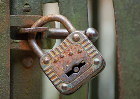 door lock love: old rusty padlock that closes the scratch of an ancient prison of bandits