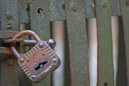 ancient prison: old rusty padlock that closes the scratch of an ancient prison of bandits