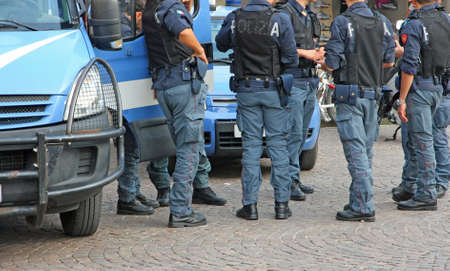 bulletproof: Italian policemen with bulletproof and armored jacket during a riot in the city Stock Photo