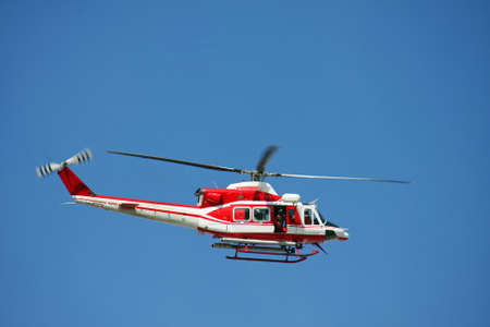patrol helicopter of firefighters in blue sky over a fire 8 photo