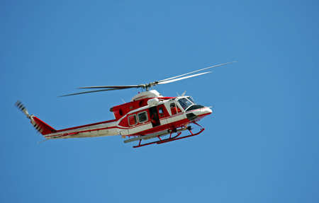 patrol helicopter of firefighters in blue sky over a fire 10 Stock Photo - 19918140