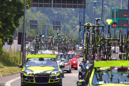 flagship: powerful machines with bicycles flagships Commons follow cyclists during the cycling race in the street