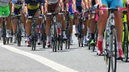 bicycle pedal: cyclists with sports during abbiglaimento during a challenging road bicycle race Stock Photo