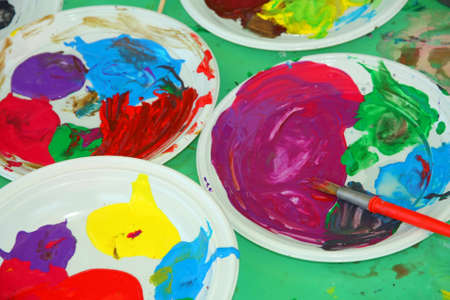 instructional: Acrylic color palettes to the nursery during the drawing lesson Stock Photo