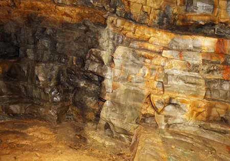 visible rock layers with ancient sediments in the mine of minerals and fossils photo