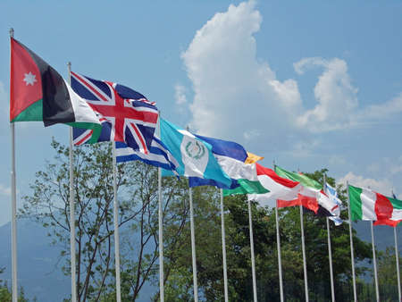 onu: set of coloured flags of many nations of the world that waving all along