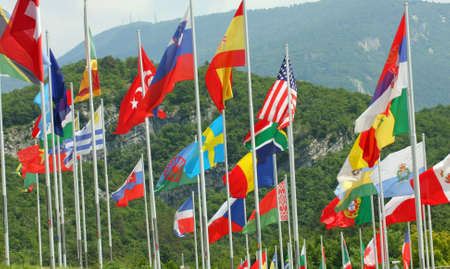 set of coloured flags of many nations of the world that waving all along photo