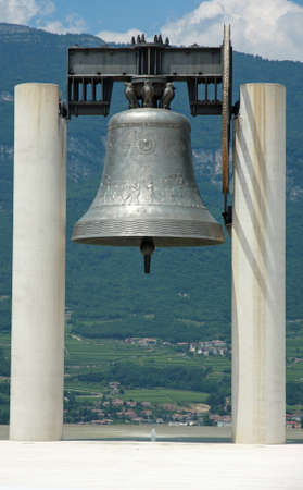 huge bronze Bell above the symbol of peace between peoples photo
