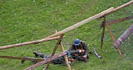 sabotage: two Italian soldiers while maintaining a sabotage operation cutting barbed wire