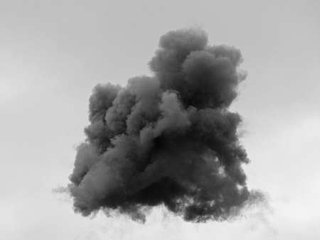 detonate: dangerous and dramatic cloud of black smoke after an explosion in the sky