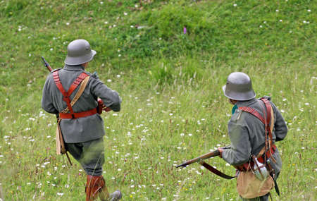 patrolling: Sentinel soldiers while patrolling a wide mountain area before the battle Stock Photo