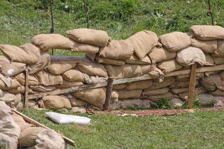 sandbag: retaining wall in a pillbox shelter of a roadblock in military war zone