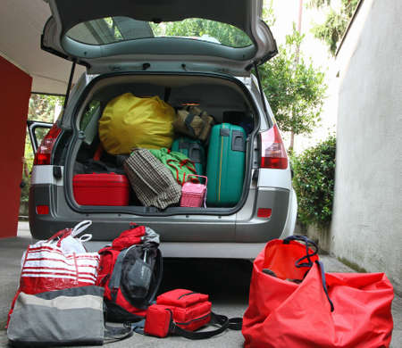 luggage full of material before leaving for the holidays Stock Photo - 21226941