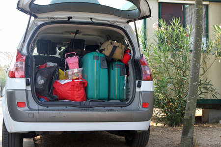 holidays vacancy: Car full of suitcases and bags before leaving for summer vacation