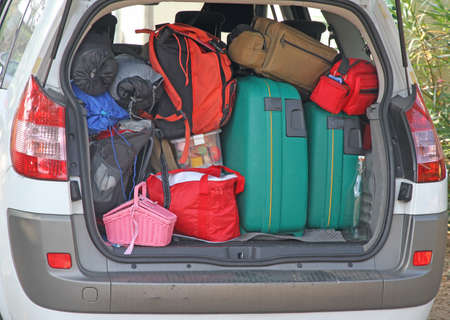 holidays vacancy: Car full of luggage before leaving for the summer holidays