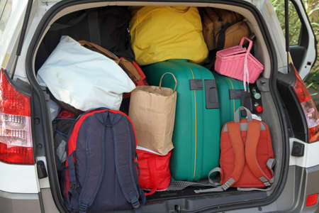 holidays vacancy: Car full of suitcases and bags to return from summer holidays Stock Photo
