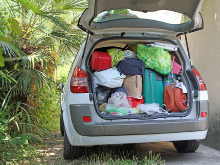 Car very full of suitcases and bags before leaving for summer vacation photo