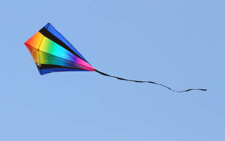 kites with the colours of the Rainbow are flying in the sky blue in summer photo