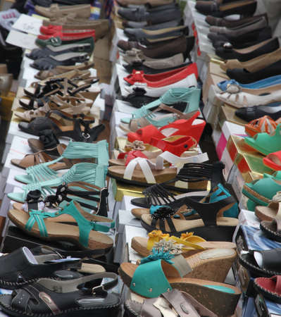Sandals and shoes for trendy young women sold at local market photo