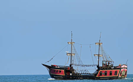 plunder: old pirate ship sails the seas in search of Board and plunder Stock Photo