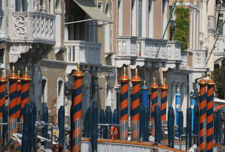 bricole and poles to anchor the gondola on the Grand canal in Venice in Italy photo