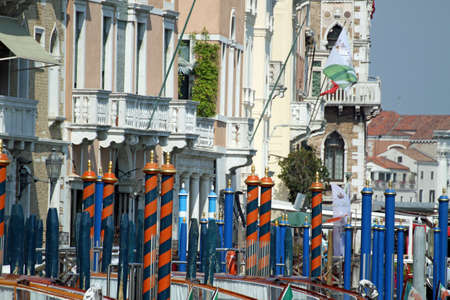 bricole and poles to anchor the gondola on the Grand canal in Venice 2 photo