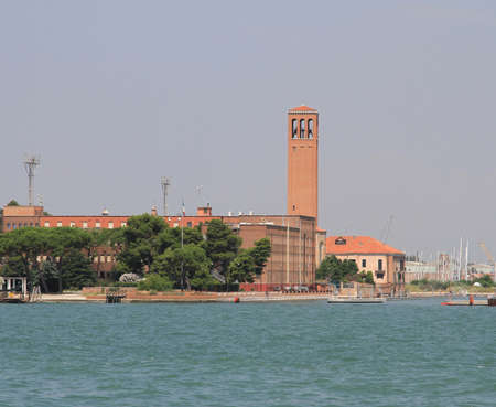 bedlam: high red brick Bell Tower on the island of SantElena in Venice in Italy