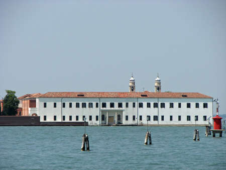 bedlam: towers and building of the University on the island of San Servolo in Venice in Italy