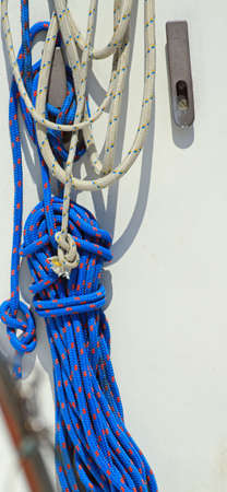 moorings: Blue rope to moor a luxurious yacht in the harbor Stock Photo