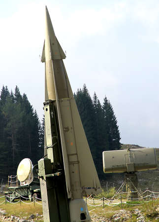 rocket military ready to go from the launching pad and radar for remote commands