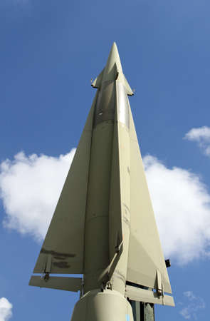 rocket with military explosive warhead for the war and blue sky and white clouds