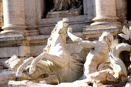 detail of the fountain of trevi in Rome with the runaway horse statue symbolizing the rough sea photo