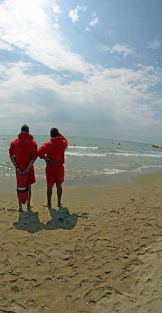 recanati: two men of the guard rescue swimmers in summer
