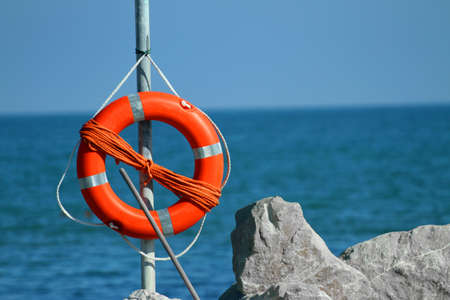 recanati: Orange lifeboat in the sea on a hot summer day Stock Photo