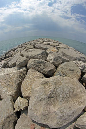 breakwaters: very picturesque seaside rocks and breakwaters photographed with the fisheye lens