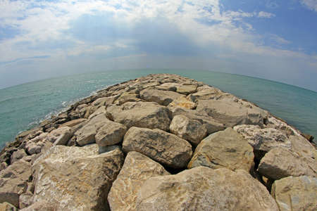 breakwaters: picturesque seaside rocks and breakwaters photographed with the fisheye lens
