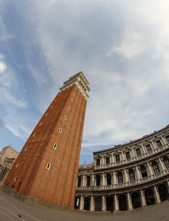 procuratie: the highest and most famous campanile in Piazza San Marco in Venice photographed with fisheye lens and the immense square