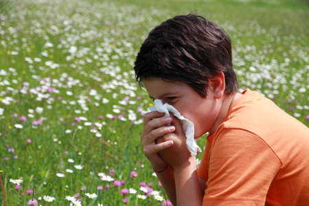 allergic child to pollen and flowers with a handkerchief while sneeze in the middle of the Minesweeper