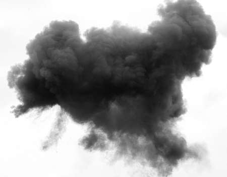environment damage: dense grey and black cloud with a thick blanket of smoke high in the white sky Stock Photo